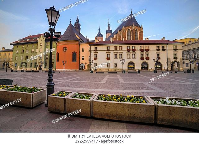 Krakow, Poland. The small market square near Mariacki church, perspective view of building's walls. Image is taken in sunrise time