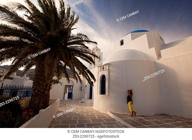 Woman in front of the the Agios Athanassios Church in Hora, Serifos, Cyclades Islands, Greek Islands, Greece, Europe