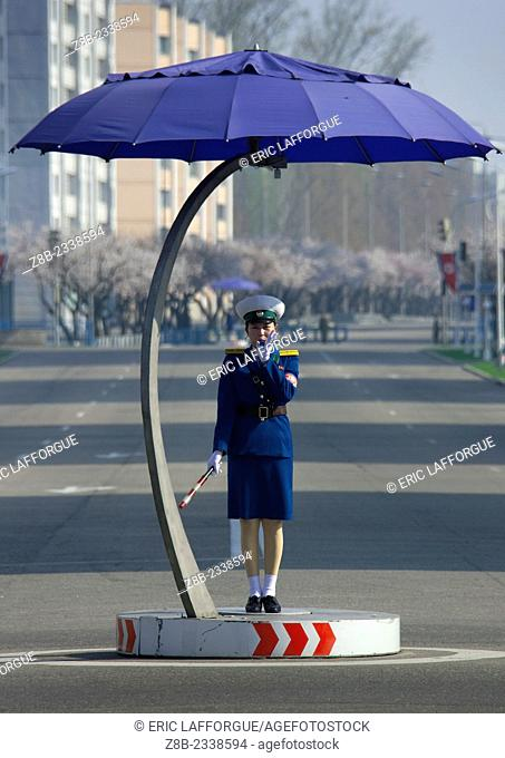 Traffic Officer Under A Giant Umbrella In Pyongyang, North Korea