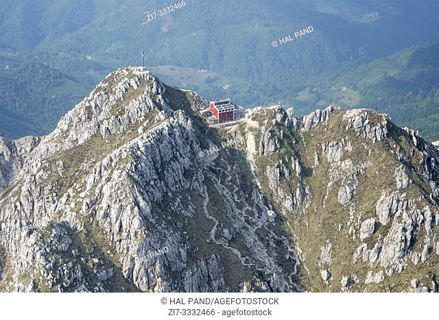aerial, from a small plane, of steep crags of Resegone peak top in Orobie mountains, shot in bright springtime light, near Lecco, Lombardy , Italy