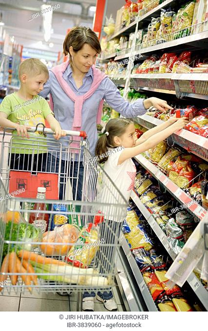Mother and children shopping for food, woman 35 years, girl 7 years and a boy 5 years