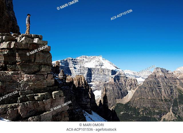 A hiker takes in the view from Sentinel Pass in Banff National Park. Model Release signed