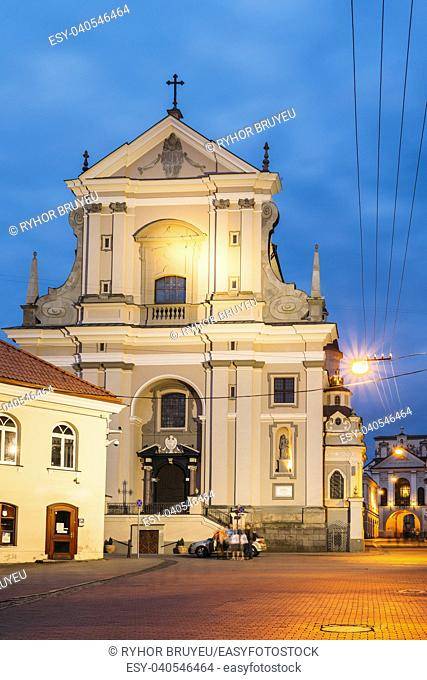 Vilnius, Lithuania. View Of Ancient Early Baroque Catholic Church Of St. Teresa On Illuminated Ausros Vartu Street. Famous Landmark Of Old Town
