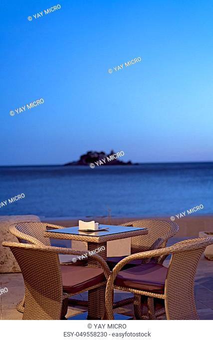 Empty reserved outdoor restaurant table at a seaside resort of Petrovac in Montenegro