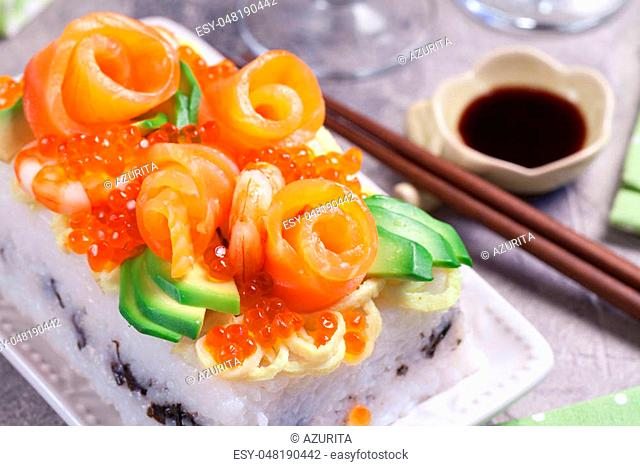 Salmon Sushi Cake with shrimp, red caviar and avocado