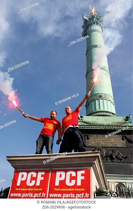 French Communist Party activists with smoke before the July column in place of the Bastille during the demonstration against pension reform, Paris