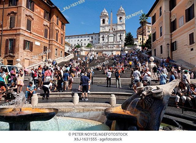The spanish steps and the Santissima Trinità dei Monti covered in tourists