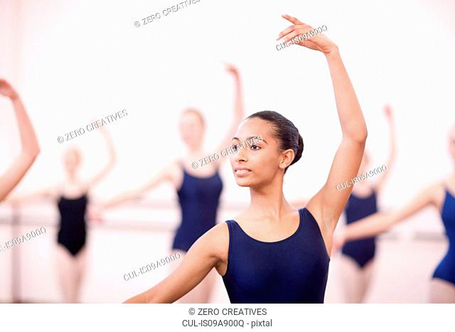 Group of synchronized teenage ballerinas