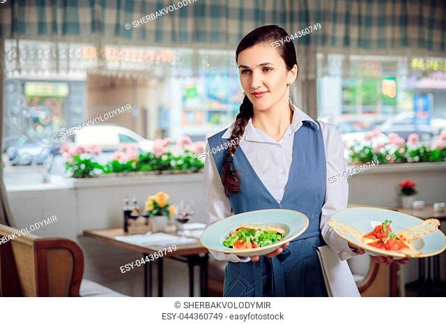 Waitress Is Carrying Two Plates With Restautant Delicious Dishes Celebration