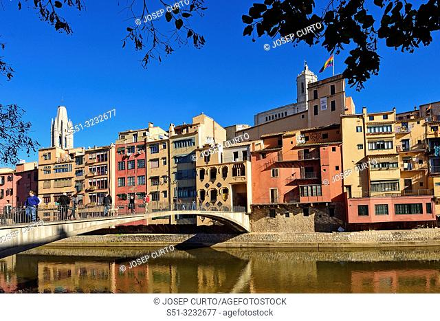 colorful houses facing the river Onyar and Sant Feliu church, Girona, Catalonia, Spain