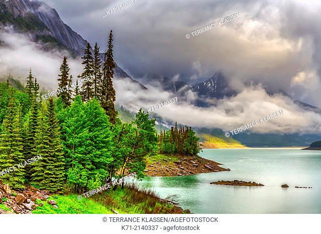 Low hanging clouds on Medicine Lake in Jasper National Park, Alberta, Canada