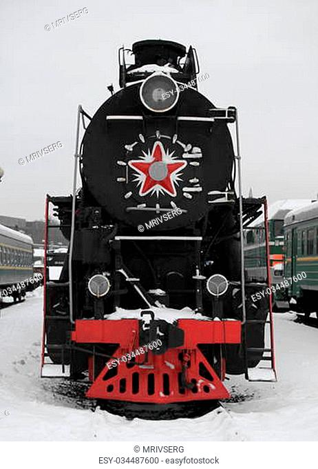 old Soviet locomotive at a train station in winter