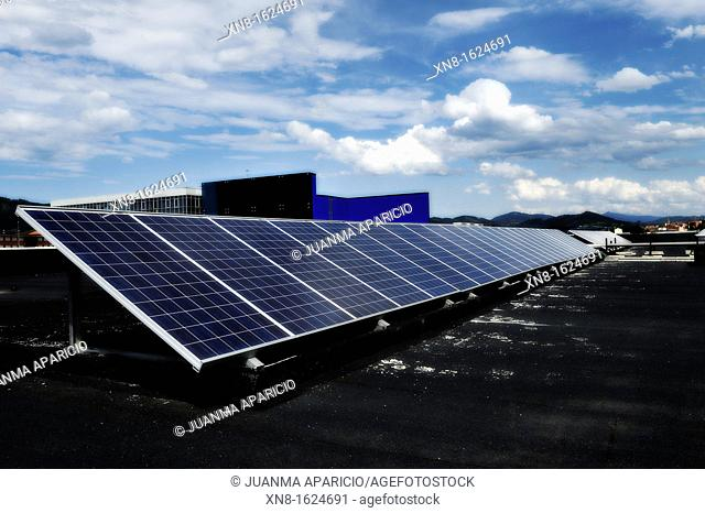 Solar panels on the roof of a modern office building