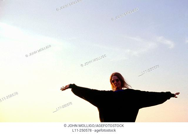 Woman, arms outstretched