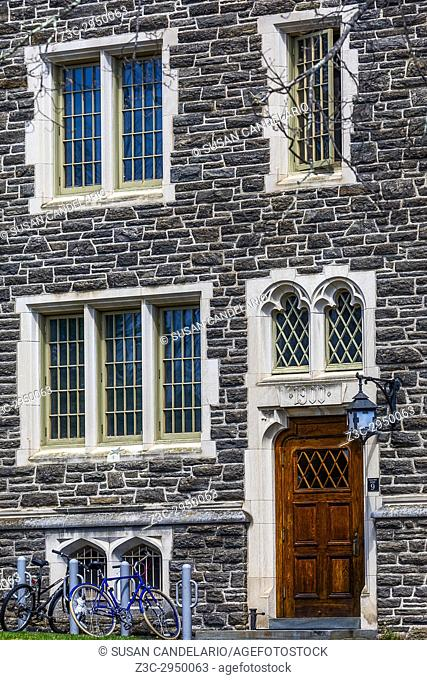 Princeton University Patton Hall No 9 - Exterior view of of windows, lamp, door, stonework and students bicycles of the now known as Patton-Wright Hall...