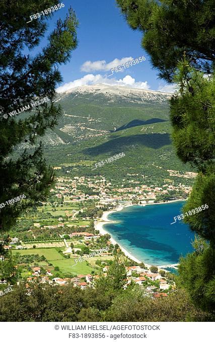 Island of Kefalonia Cephalonia, Greece: Sami and Sami Bay framed by pines, Agia Dinati Mountain beyond, windmills near summit