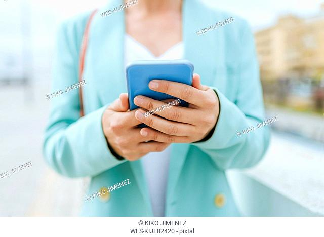 Close-up of woman's hands with smartphone