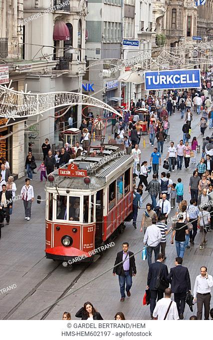 Turkey, Istanbul, Beyoglu, Taksim district, Istiklal Caddesi shopping street is crossed by an ancient tram back