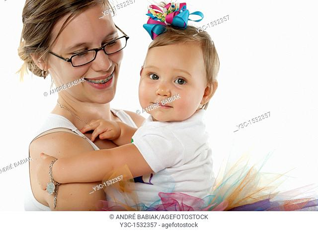 Very young mother with baby girl