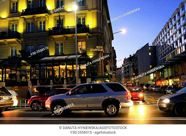 Europe, Switzerland, Geneva, Quai du Mont Blanc at night, on right 5 star Hotel d'Angleterre, on right windows of Grand Hotel Kempinski Geneva