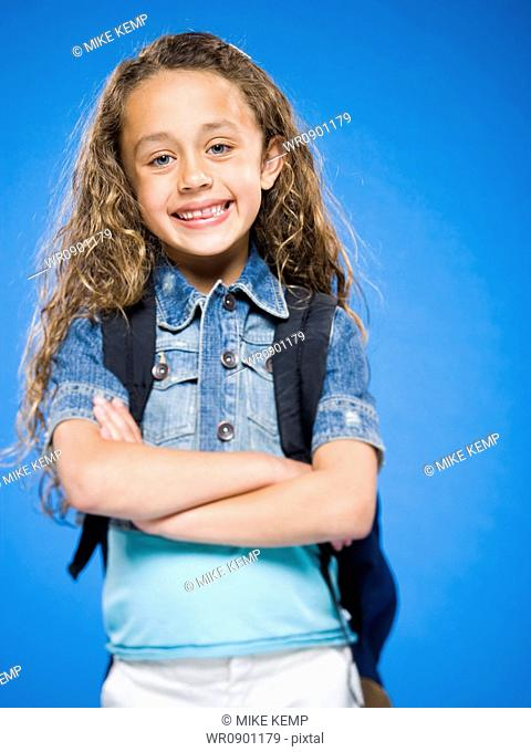 d144a09feb Girl arms crossed backpack Stock Photos and Images