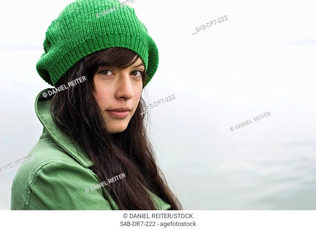 Woman wearing coat and beanie, Lake Starnberg, Bavaria, Germany