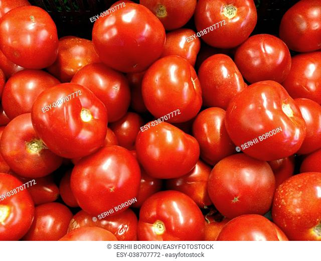Red tomatoes background. Group of tomatoes . Background for market