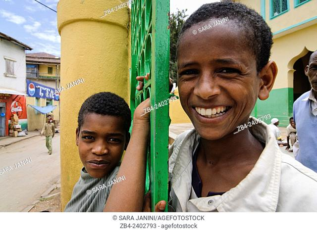 Portrait of local kids at the doors of Jamia Mosque, built in the 16th century, Old Town, Harar, town listed as World Heritage by UNESCO, Ethiopia, Africa