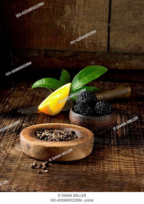 Black truffles, peppercorns and orange