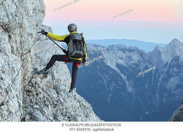 Europe, Italy, Veneto, Agordino, mountain climber on the via ferrata Stella Alpina at mount Agner, Pale di San Martino, Dolomites