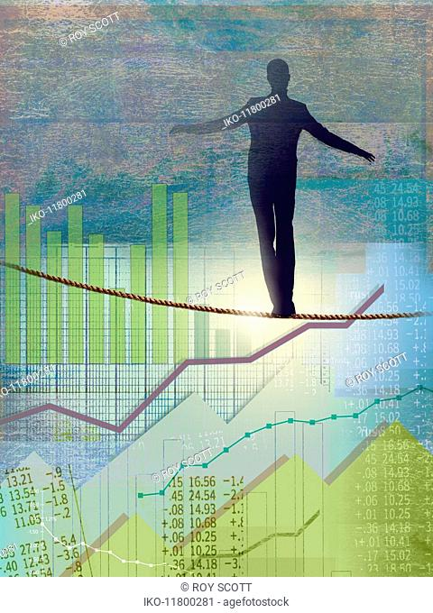 Businessman walking tightrope over graphs and financial figures
