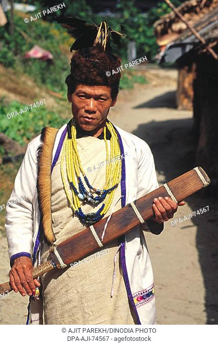 Dao - large knife in man's hands , 'Miji' tribe man with traditional dress , Arunachal Pradesh , India