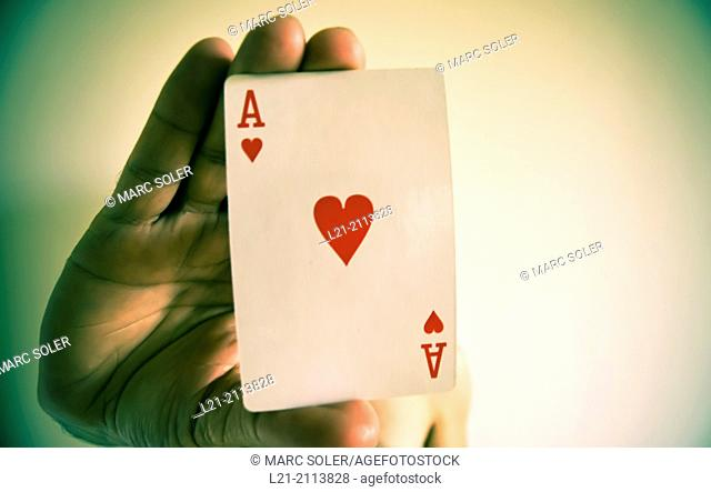 Hand holding an ace of hearts