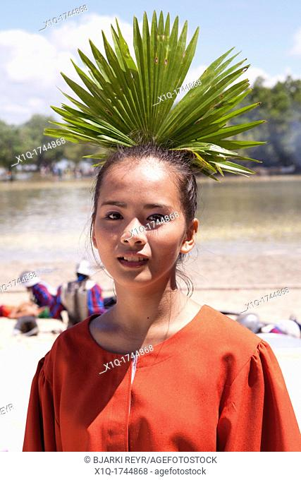 Filipina wearing a traditional dress and Anahaw leaf at the Battle of Mactan reenactment or Kadaugan Festival  The Battle of Mactan was fought in the...