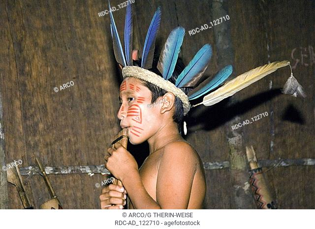 Young Indian boy of the tribe of Dessanos with pan pipes Rio Taruma Amazon state Brazil music