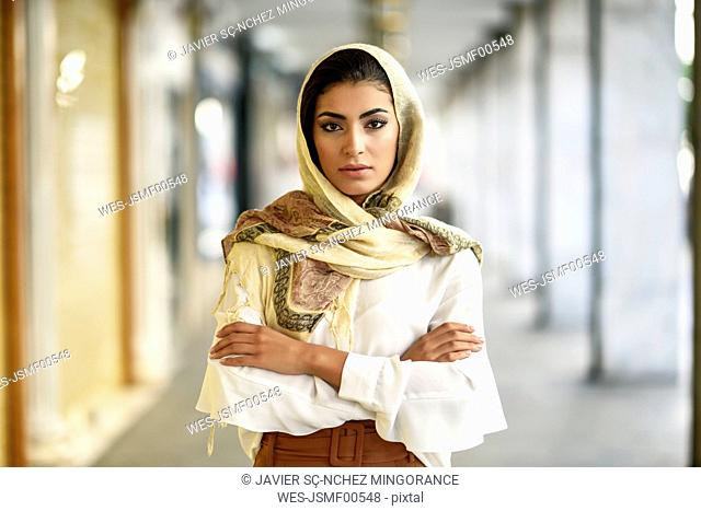Spain, Granada, young muslim tourist woman wearing hijab in urban city background