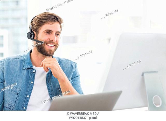 Happy operator with earpiece