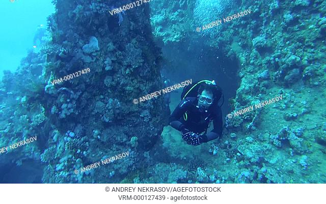 A diver swims next to the propeller of the the wrecked ship SS Carnatic, Red Sea, Egypt