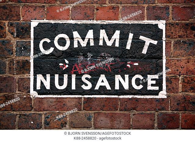 Commit no nuisance sign in laneway in Melbournes Chinatown. Victoria, Australia