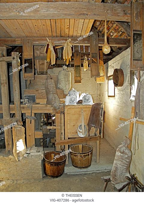 interior view from an old mill with flour sacks and corncobs in the flower park Mozirski Gaj in the town Mozirje in the in the valley of the river Savinja in...