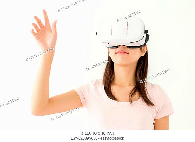 Woman play game with vr device and arm raised up
