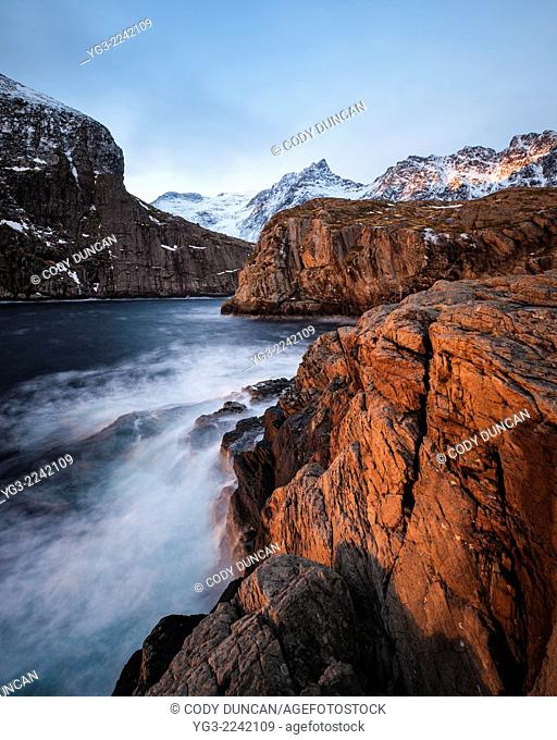 Winter light on coastal sea cliffs at Š, Moskenesøy, Lofoten Islands, Norway