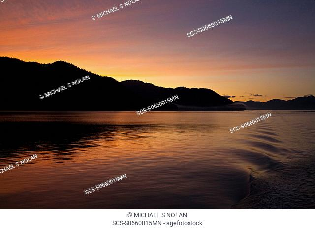 Sunset from the stern of the Lindblad Expeditions ship National Geographic Sea Bird in Lynn Canal, Southeast Alaska, USA