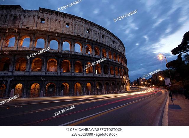 The Roman Colosseum and car light-trails, Rome, Lazio, Italy