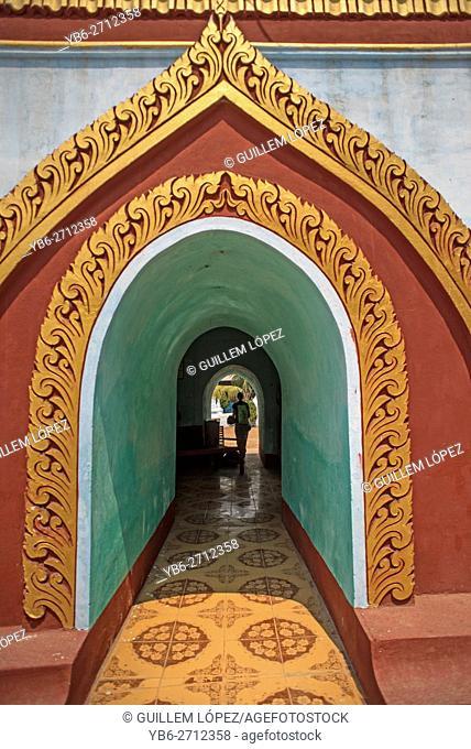 Ornated entrance door in a Buddhist pagoda in Sagaing Hills, Near Amarapura, Myanmar