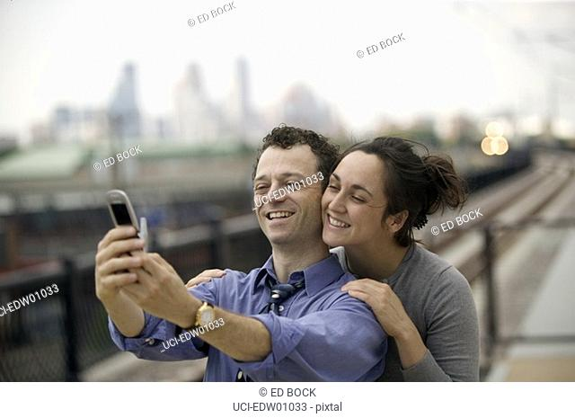 Couple taking self-portrait with camera phone