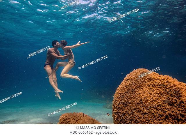 The swimmers Federica Pellegrini and Filippo Magnini kissing each other under the sea in Capo Coda Cavallo. Olbia-Tempio, Italy. 15th August 2015