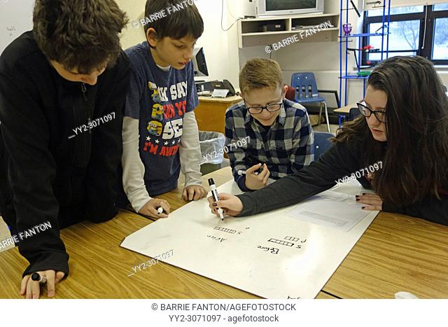 6th Grade Students Working on Math Project, Wellsville, New York, USA