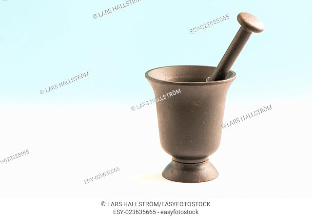 Iron mortar and pestle. Kitchen utensil for food preparation