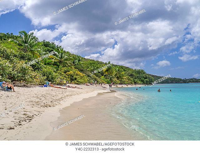 People enjoying Hawksnest Bay Beach on the Caribbean Island of St John in the US Virgin Islands